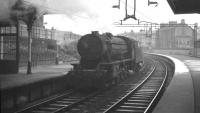 An ex-WD Austerity 2-8-0 runs tender first through Coatbridge Sunnyside in September 1961 heading for Kipps shed.<br><br>[K A Gray 25/09/1961]