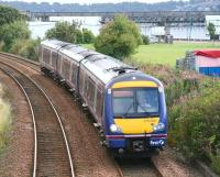 An afternoon Dundee - Glasgow Queen Street service approaches the site of the former Magdalen Green station on 20 September 2007. In the background maintenance work is underway at the north end of the Tay Bridge.<br> <br><br>[John Furnevel&nbsp;20/09/2007]