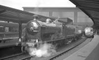 The SLS/MLS 'Carlisle Rail Tour' stands at platform 5 of Carlisle station on 6 April 1963. Locomotive no 256 <I>Glen Douglas</I> handled the tour throughout, which visited various lines and yards in and around the city, as well as making a return trip over the Langholm branch [see image 31793].    <br><br>[K A Gray&nbsp;06/04/1963]