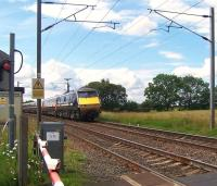 Down ECML train about to pass over Ulgham Lane level crossing south of Widdrington, Northumberland, on 19 July 2011, heading for Edinburgh Waverley. <br><br>[Colin Alexander&nbsp;19/07/2011]