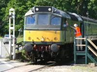 <I>'...and you!'</I> Exchange at New Bridge level crossing on 29 June 2011. The train is the 10.00 ex-Pickering seen shortly after getting underway behind D7628.<br><br>[John Furnevel&nbsp;29/06/2011]