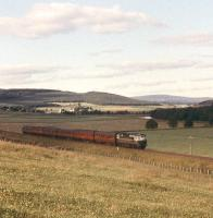 A Birmingham Type 2 slows for the Broomhill stop with a southbound Inverness-Forres-Perth train in 1961 [see image 26960]. <br><br>[Peter Oliver Collection (Courtesy David Spaven)&nbsp;//1961]
