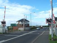 Newsham South level crossing and signal box on the Blyth & Tyne, looking west towards Cramlington on 19 July 2011. Newsham station, which stood less than half a mile to the north, lost its passenger service in November 1964.<br><br>[Colin Alexander&nbsp;19/07/2011]