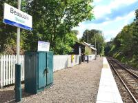 The small station at Beasdale looking east into the sun on 21 July. The original station building is now privately owned and waiting passengers are now provided with a wooden shelter.<br> <br><br>[John Gray 21/07/2011]