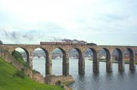 Standard Class 2 no 78048 takes the last passenger train from Berwick to Kelso and St Boswells across the Royal Border Bridge shortly after 6.35pm on 13th June 1964. The loco will run round its train at Tweedmouth station (which also closed the same day) in order to access the branch line.<br><br>[Frank Spaven Collection (Courtesy David Spaven)&nbsp;13/06/1964]