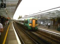A train for London Victoria coasts into Chichester on 2 July 2011. An airy and well-kept station.<br><br>[Ken Strachan&nbsp;02/07/2011]
