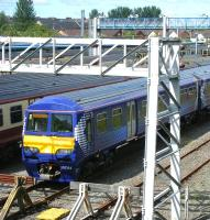 320314 basks in the sunshine at Yoker depot on 23 July 2011.<br><br>[Veronica Clibbery&nbsp;23/07/2011]