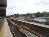 Platform 4 at Blackburn, normally used for Manchester and Preston bound services, is temporarily out of use while a new waiting room is constructed. This means that all passenger trains are being concentrated on the island platform (and its bay) and the rails through Platform 4 are gathering rust. This view looks east towards Blackburn tunnel from Platform 2 and shows the work in progress. <br><br>[Mark Bartlett&nbsp;23/07/2011]