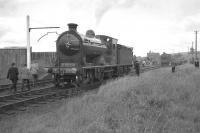 The RCTS (West Riding Branch) <I>'Borders Rail Tour'</I> at Greenlaw on 9 July 1961, having recently arrived from Hawick behind no 256 <I>Glen Douglas</I> and J37 no 64624. The locomotives are in the process of carrying out run round manoeuvres prior to making the trip back to St Boswells. Greenlaw station building stands in the right background with the road bridge just beyond.<br><br>[K A Gray&nbsp;09/07/1961]