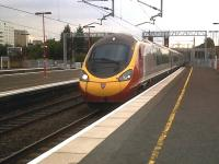The styling of the Southbound Pendolino {the 19.20 to Euston} blends in well with this starkly modern station serving the NEC and Birmingham Airport.<br><br>[Ken Strachan&nbsp;21/07/2011]