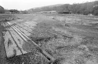 Looking north west over the remains of the old goods yard at Galashiels in 1975. The station site is in the centre background with Station Brae road bridge crossing left to right.<br><br>[Bill Roberton&nbsp;//1975]