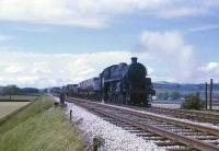 Standard 4MT 4-6-0 75019 hauls a short freight towards Settle Junction on the <I>Little North Western</I> line from Carnforth in the summer of 1968. This loco was the last Std 4MT in service and made it to the <I>End of Steam</I> [See image 27896]. It was even used on a trip freight working to Lancaster Power Station as late as 2nd August 1968 but unfortunately did not pass into preservation. <br><br>[David Hindle&nbsp;/06/1968]