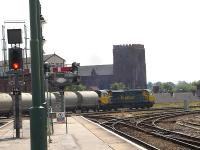 Freightliner 70005 heads south out of Shrewsbury shortly after mid-day on 14 July with the normally class 66 rostered loaded Lafarge cement working from Hope to Aberthaw.<br><br>[David Pesterfield&nbsp;14/07/2011]