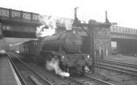 St Margarets V2 2-6-2 no 60931 waits to depart Carlisle on a dull and overcast 27 February 1965 with the 1.45pm train for Edinburgh via the Waverley route. The locomotive is thought to be deputising for a diesel failure on this occasion.<br><br>[K A Gray&nbsp;27/02/1965]