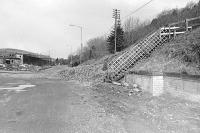 The trackbed viewed looking north through the site of Peebles NB Station (closed February 1962) being cleared to make way for a road in 1975. [See image 28603]<br> <br><br>[Bill Roberton&nbsp;//1975]