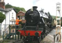 Scene at New Bridge level crossing on the northern outskirts of Pickering on 1 July 2011 with Black 5 no 45407 <I>'The Lancashire Fusilier'</I> bringing in the 10.30 train from Grosmont.  <br><br>[John Furnevel&nbsp;01/07/2011]