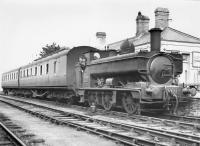 Armstrong GWR 850 class 0-6-0PT no 2011 of 1894/95 stands at the platform at Cardigan station [closed to passengers 1962]. Thought to have been taken in the early 1950s. [See image 35095]<br><br>[W A Camwell Collection (Courtesy Peter Francis)  //]