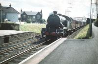 Looking east into the sun at Joppa station on 11 July 1959 as V3 2-6-2T no 67670 brings a Waverley bound train into the platform. A pedestrian footbridge still links Morton Street and South Morton Street in the background - but today's version looks nothing like this one!<br><br>[A Snapper (Courtesy Bruce McCartney)&nbsp;11/07/1959]