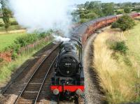 Working hard on the curving climb from Farington Curve Junction to Lostock Hall, 46115 <I>Scots Guardsman</I> approaches Coote Lane bridge on 27 July 2011 with the outward working of 'The Fellsman' from Lancaster to Carlisle.<br><br>[John McIntyre&nbsp;27/07/2011]
