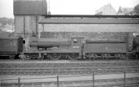 Standing in the shed yard at Hawick on 28 June 1958 is Scott class 4-4-0 no 62425 <I>'Ellangowan'</I>. At this point the locomotive had 2 months left before official withdrawal by BR.<br><br>[Robin Barbour Collection (Courtesy Bruce McCartney)&nbsp;28/06/1958]