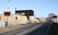 Coopies Lane level crossing and signal box in Morpeth just north of the current ECML station (behind camera to left) and the former Blyth and Tyne station (behind camera to right). View north on 8 November 2007. <br><br>[John Furnevel&nbsp;08/11/2007]