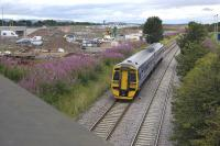Fife-bound 158870 passes the site of the proposed tram/train interchange at Gogar on 1 August 2011.<br> <br><br>[Bill Roberton&nbsp;01/08/2011]