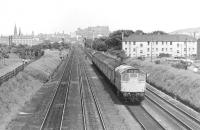 View east from Saughton Junction in 1975 as a push-pull train from Glasgow Queen Street powered by a class 27 locomotive at each end runs towards Haymarket West Junction. This view is no longer possible due to construction of the tram flyover [see image 34412].<br> <br><br>[Bill Roberton&nbsp;//1975]