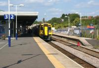 A York - Blackpool service pulls into platform 2 at Blackburn <br> station on 30 July 2011. On the right is the currently out of use platform 4 which is having work carried out to create shelter for passengers during inclement weather.<br> <br><br>[John McIntyre 30/07/2011]