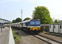 Hanson liveried 59103 <I>Village of Mells</I> drifting through Westbury with an aggregates train on 3 August 2011. A passenger line is to be relaid alongside this platform.<br> <br><br>[Peter Todd&nbsp;03/08/2011]