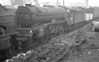 Gresley V2 2-6-2 no 60873 <I>Coldstreamer</I> stands amongst the clutter at Heaton shed on 10 February 1962. The V2 was withdrawn by BR at the end of that year.<br><br>[K A Gray&nbsp;10/02/1962]