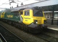 <I>Ahhh go on... give us a smile!</I> Freightliner 70.001 <I>'Power Haul'</I> shows off its curves as it heads South through Nuneaton station with containers on 15 July 2011.<br><br>[Ken Strachan&nbsp;15/07/2011]