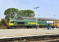 Freightliner 66606 with a PW train passing through Westbury station on 3 August heading towards London.<br><br>[Peter Todd&nbsp;03/08/2011]