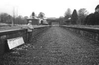 On the other side of the camera for a change. The rarely photographed Frank Spaven surveys the remains of Comrie station at Easter 1966 in this view from the west. The railway to Crieff and Gleneagles had closed in 1964, but the track appears to have been lifted only recently.<br> <br><br>[David Spaven&nbsp;//1966]