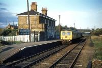 An Ipswich to Lowestoft DMU pauses at the down platform of Wickham Market for Campsea Ash station in November 1976. A more accurate description would have been Campsea Ash for Wickham Market - the latter being some 2 miles away.<br><br>[Mark Dufton&nbsp;07/11/1976]