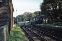 The former station at Bealings, on the East Suffolk line, photographed in November 1976, some 20 years after closure to passengers. The view is towards Woodbridge. The manual crossing gates and signal box lasted until the spring of 1984.<br><br>[Mark Dufton&nbsp;07/11/1976]
