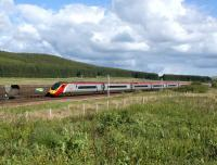 A southbound Pendolino passes a Freighliner coal train from <br> Ravenstruther to Drax which has been looped at Beattock Summit on 30 May 2011. <br> <br><br>[John McIntyre&nbsp;30/05/2011]