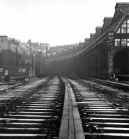 The carriage sidings on the west side of the Princes Street train shed were lifted not long before this winter 1965-66 shot was taken. The buildings to the left on Rutland Square survive to this day along with the distant Caledonian Hotel, not to mention the former station entrance itself [see image 8250]. <br> <br><br>[David Spaven&nbsp;//1965]