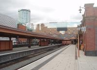 The reopened and restored bay platforms at Moor Street station, looking towards the buffers in June 2011. The attention to period detail throughout the renovation of this busy commuter station is striking. The <I>Bull Ring</I> tower in the background overlooks the south end of Birmingham New Street and illustrates how close to each other the two stations are situated. [See image 48181] for the same scene ten years earlier.<br><br>[Mark Bartlett&nbsp;08/06/2011]