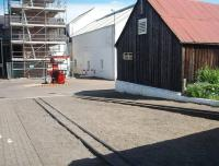 Rails at the Dallas Dhu historic distillery in July 2011 - now a museum operated by Historic Scotland but with bonded warehousing still on the site. The rails lead to two bonded warehouses but are now used to roll whisky barrels along. The Forres - Aviemore line ran behind the buildings in the picture and the bonded warehouses are behind the camera. [See image 16632]<br> <br><br>[Mark Bartlett&nbsp;02/07/2011]