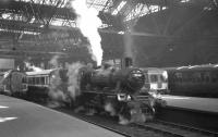 BR Standard class 2 2-6-0 no 78046 stands at Edinburgh's Princes Street station on 19 April 1965 at the head of the SLS/BLS <i>Scottish Rambler no 4</i> railtour. The locomotive took this section of the tour on a trip over the Balerno branch [see image 20499].<br><br>[K A Gray&nbsp;19/04/1965]
