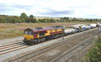 DBS 66116 heading west towards Didcot on 11 August 2011 in the process of restarting following a red signal. Note the 'heavy lift' Balfour Beatty crane in the consist.<br> <br><br>[Peter Todd 11/08/2011]