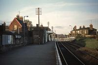 The station at Saxmundham in November 1976, photographed from the former staggered down platform.  This platform, together with its associated buildings, was removed in the early 1980s and replaced with one opposite the up platform.<br><br>[Mark Dufton&nbsp;07/11/1976]