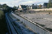 The cleared site of the original Alloa station platforms and goods yard in November 1985, showing retention of a chord of disused track from Cambus through to Kincardine and Longannet. Foundations are being laid for the Leisurebowl complex which still dominated this view in 2011. The foresight of those who insisted that the trackbed should be protected from development is to be highly commended. [See image 13340]<br><br>[Mark Dufton&nbsp;/11/1985]