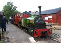 At the end of the first day of the West Lancashire Light Railway <br> Gala Weekend, three Hunslet Quarry 0-4-0ST locomotives stand at Becconsall having just arrived with the penultimate train of the day on 13 August 2011. Nearest the camera is 'Jack Lane' with 'Statfold' and 'Irish Mail' behind. The first two of these locos were built in the first decade of the 21st century while 'Irish Mail' is an original having been built in 1903.<br> <br><br>[John McIntyre&nbsp;13/08/2011]