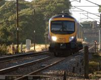 On the long straight through the site of the former Brock station, <br> an Edinburgh to Manchester Airport service is approaching the foot <br> crossing on the evening of 8 August 2011.<br><br>[John McIntyre&nbsp;08/08/2011]