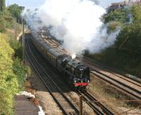 The Compass Tours 'Mersey Moorlander' charter sets off south from Preston on 15 August behind Britannia Pacific no 70013 <I>Oliver Cromwell</I>. The special is seen approaching Farington Curve Junction where it will swing west before crossing the WCML <br> and heading east towards Blackburn.<br> <br><br>[John McIntyre&nbsp;15/08/2011]