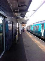 Newport (High Street) station was extended for the Ryder Cup last year (2010).<br><br> <br><br> This view is of the new platform 4 with a class 150 about to depart for Gloucester.<br><br>[John Thorn&nbsp;16/07/2011]
