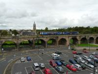 Class 156, 156501 runs over Kilmarnock Viaduct with 1E96, the 13.49 from Glasgow Central to Newcastle Central service. Photo taken from the rooftop of the adjacent multi-storey car park.<br><br>[Ken Browne&nbsp;17/08/2011]