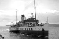 The worlds first diesel electric paddle vessel <I>Talisman</I> arriving at Largs from Millport on a Sunday in July 1966. Built for the London and North Eastern Railway in 1935 by  A & J Inglis (later builders of PS Waverley) at Pointhouse on the Clyde, she was withdrawn shortly after this picture was taken and eventually scrapped at Arnott Youngs, Dalmuir.  <br> <br><br>[Colin Miller&nbsp;/07/1966]