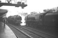 Stanier Pacifics 46225 <I>Duchess of Gloucester</I> and 46240 <I>City of Coventry</I> let off steam on the centre roads at Carlisle on 28 December 1963, while D323 stands at platform 3 with a Glasgow Central - Liverpool train.<br><br>[Robin Barbour Collection (Courtesy Bruce McCartney)&nbsp;28/12/1963]